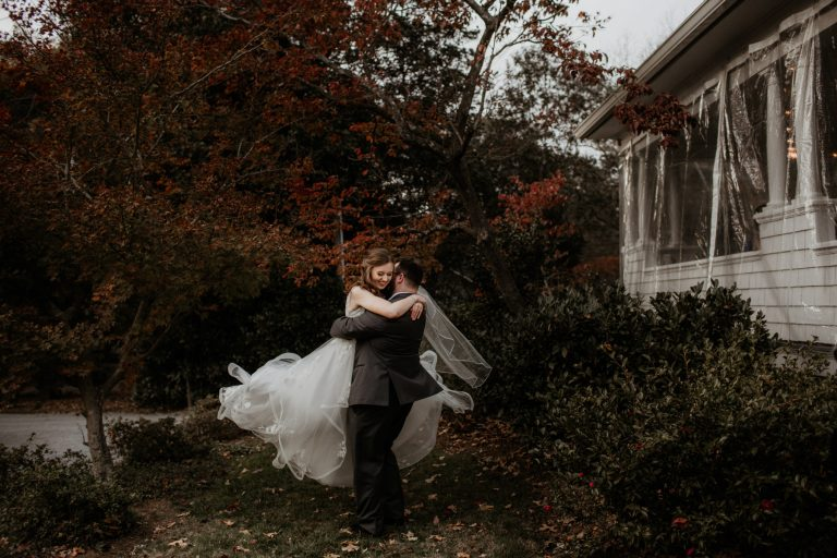 Bride and groom twirling at Ritchie Hill wedding venue in concord, NC